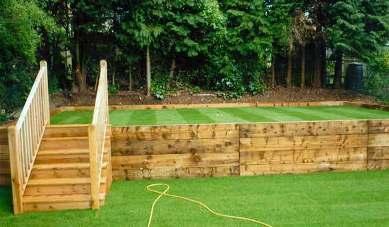 Levelled lawn with retaining wall in new railway sleepers, High Wycombe